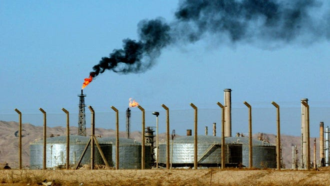 An oil refinery is seen in the city of Beiji, home to Iraq's largest oil refinery, in 2003.