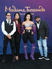 Selena Quintanilla's wax figure, center, is surrounded