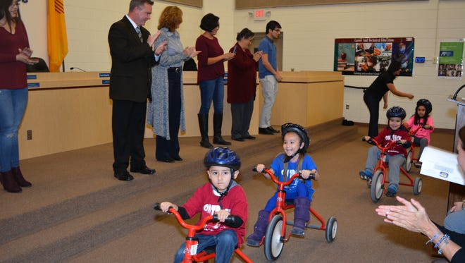 GISD On-Track Pre-K students race around the board room, demonstrating their skills and how they were part of funding raising efforts that assisted various charitable agencies.