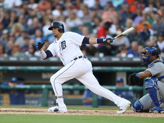 Tigers designated hitter Victor Martinez singles during the second inning on Tuesday, July 25, 2017, at Comerica Park.