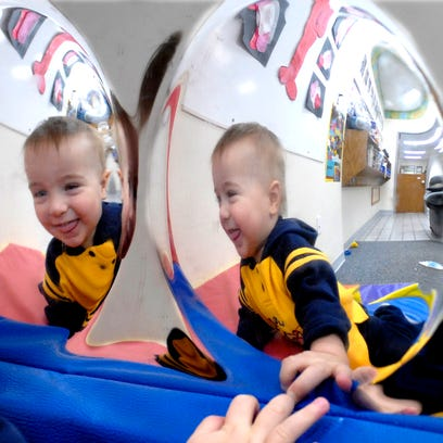 Zachery Woods, 2, has a choice of hoops as he plays basketball at the Little Miracles Family Child Care in the town of Menasha in this 2004 file photo.