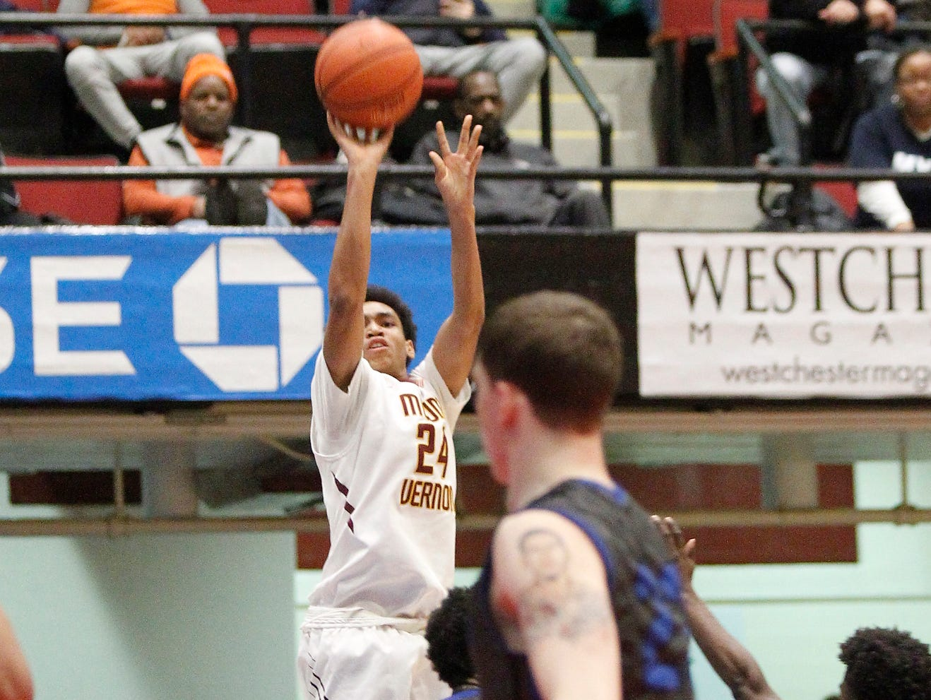 Mount Vernon's Jason Douglas-Stanley (24) puts up a shot during the boys Class AA semi-final basketball game against Saunders at the County Center in White Plains on Friday, February 26, 2016.