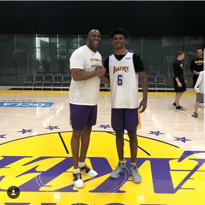 Alize Johnson with NBA legend Magic Johnson