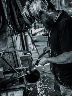 Molino bladesmith and knife maker Wayne Meligan poses for a photo.