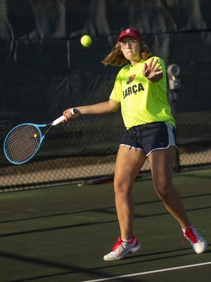Galesburg High School senior Gwendolyn Allison prepares to return a serve Tuesday morning during tennis practice for the Silver Streaks at the Art Fish Memorial Tennis Courts.