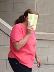 Terry Gow walks out of Broome County Court on May 29,