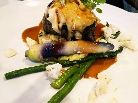 LouRonzo's Filet di Manzo was tender beef seasoned with a mesquite smoked salt. It was topped with a pungent goat brie offset by sweet lump crab meat all complimented by an earthy black truffle polenta. It was accompanied by asparagus and a heirloom carrot.