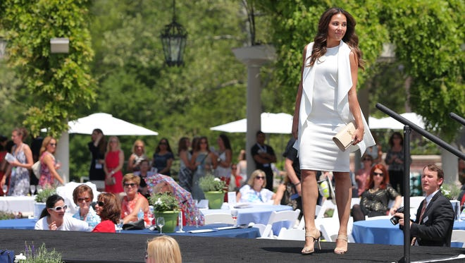 Jessica Jackson of Indianapolis models clothes and accessories on the runway during the annual Wine, Women and Shoes luncheon held at the Lucas Oil Estate benefitting Gleaners Food Bank of Central Indiana on Friday, May 15, 2015. The event featured wine tasting, auctions, fashion marketplaces and a fashion show created for women who enjoy fine wine, great style, and female camaraderie.
