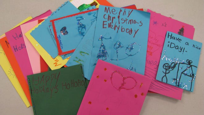 Cards made by children are given out at the Union Gospel Mission's annual Christmas Eve Feast.