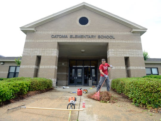 Officer Trainee Michael Addis cleans up Catoma Elementary on Saturday.