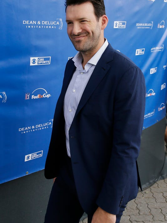 Former NFL quarterback Tony Romo leaves the broadcast booth after appearing on air during the third round of the Dean & DeLuca Invitational golf tournament at Colonial Country Club in Fort Worth, Texas, Saturday, May 27, 2017. The former Dallas Cowboys quarterback, hired last month to be the network's lead NFL analyst, was on the air Saturday for a few minutes during the coverage of the PGA Tour event at Colonial. (AP Photo/LM Otero)