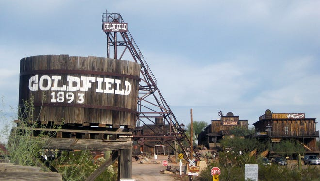 A large water tank dominates the entrance to Goldfield, a restored 1890s mining town just northeast of Apache Junction.
