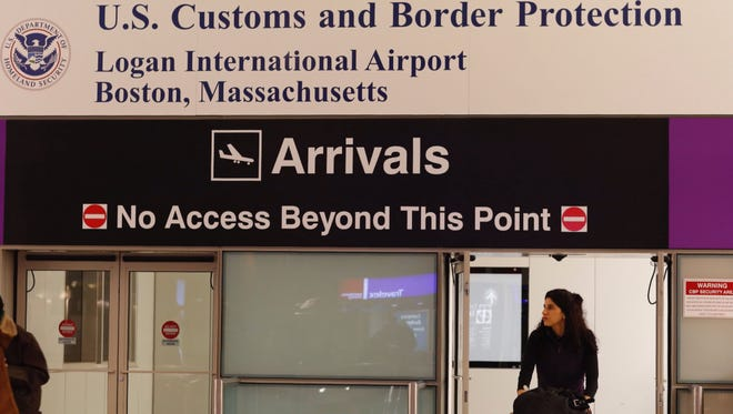 A passenger arrives through the U.S. Customs and Border Protection gate at Logan International Airport in Boston, Mass., on Dec. 4, 2017.