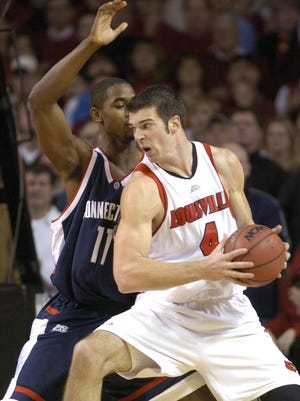 """-  -Text: JAN 21 06 PHOTO BY PAT MCDONOGH The Unniversity of Louisville men's basketball team took on Big East opponent Connecticut at Freedom Hall. UL's David Padgett, right, puts a move on UConn's #11 Hilton Armstrong. Padgett had a game high 27 points(pls cq).-  -Caption: U of L's David Padgett, operating against shot-blocking specialist Hilton Armstrong, was unstoppable inside, scoring a career-high 27 points and grabbing eight rebounds. """"He was equal to two of our big guys,"""" UConn coach Jim Calhoun said."""