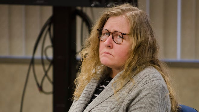 Judy Higley-Zuehlke listens to testimony Tuesday, Jan. 10 during her trial in Judge Michael West's courtroom in Port Huron.