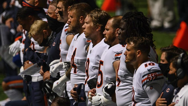 Chicago Bears players lock arms during the anthem before Sunday's game against the Atlanta Falcons, iin Atlanta. The Chicago Bears won 30-26.