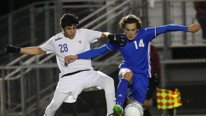 Shadow Hills High School's #28 tries to stop Indio High School's central forward Sebastian Rodriguez.