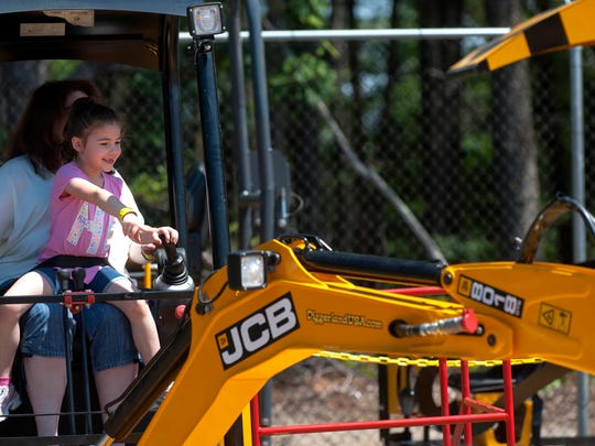 Cheryl Goldman and her daughter Tara, 6, of Cherry Hill, dig with a mini digger at Diggerland in Berlin Township on opening day on Saturday, June 14, 2014.