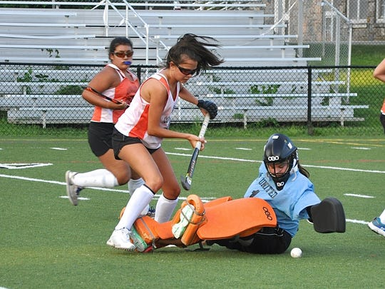 Freshman goalie Sam Maresca slides out to stop teammate Brigid Knowles during a Mamaroneck field hockey practice this week. Photo from Aug 21, 2017.jpg