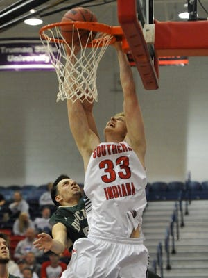 USI's Davis Carter goes up for the slam dunk while being fouled by Lees-McRae's Keegan Crabtree during USI's home opener at the PAC in Evansville Wednesday.