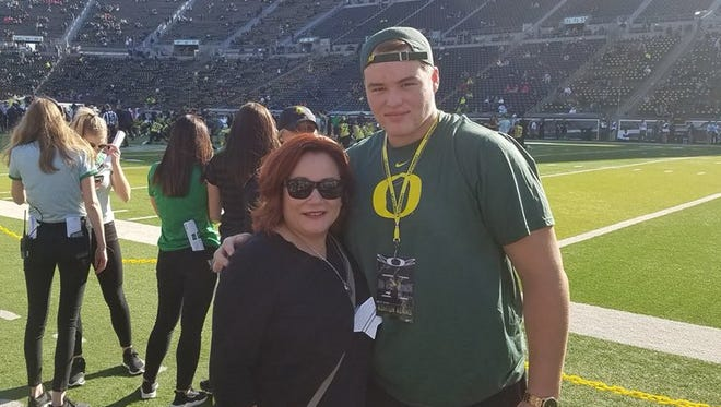 South Salem football player Ashton Adams with his mom, Veronica Hillebrand, during a recruiting trip to the Oregon Ducks.