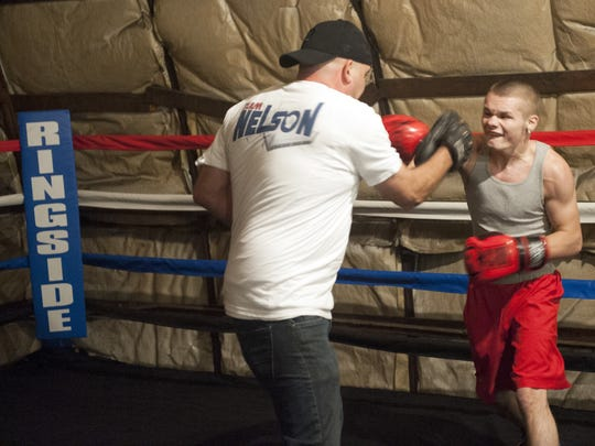 Chaise Nelson, sparring with his dad and co-manager Mike, has signed a contract with Probox Management and will make his pro boxing debut in Mexico in February.