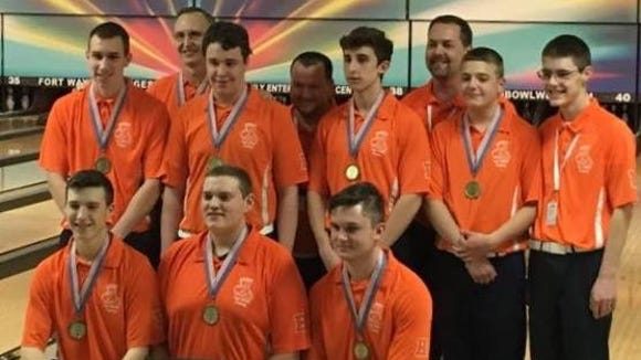 Harrison's bowling team celebrates its recent state