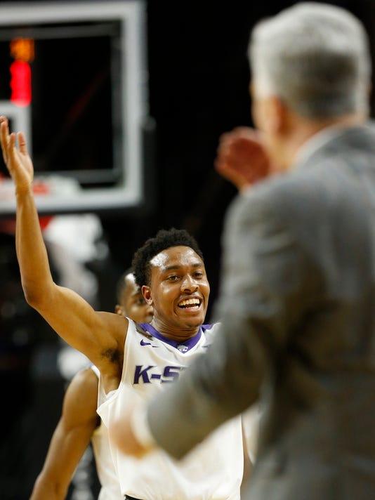 Kansas State guard Kamau Stokes (3) celebrates in the first half of an NCAA college basketball game against TCU, Wednesday, Feb. 1, 2017, in Manhattan, Kan. (Bo Rader/The Wichita Eagle via AP)