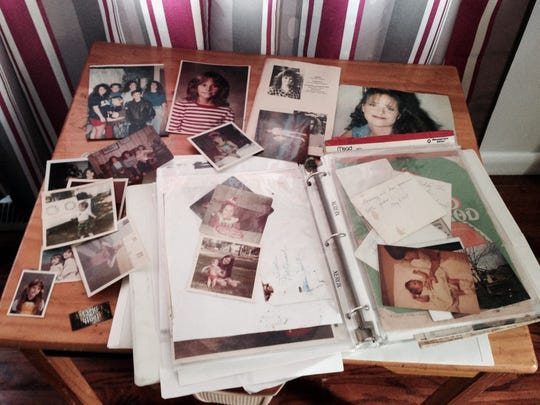 These are some of the many childhood photographs and memorabilia of Heather Teague kept by her mother, Sarah Teague.