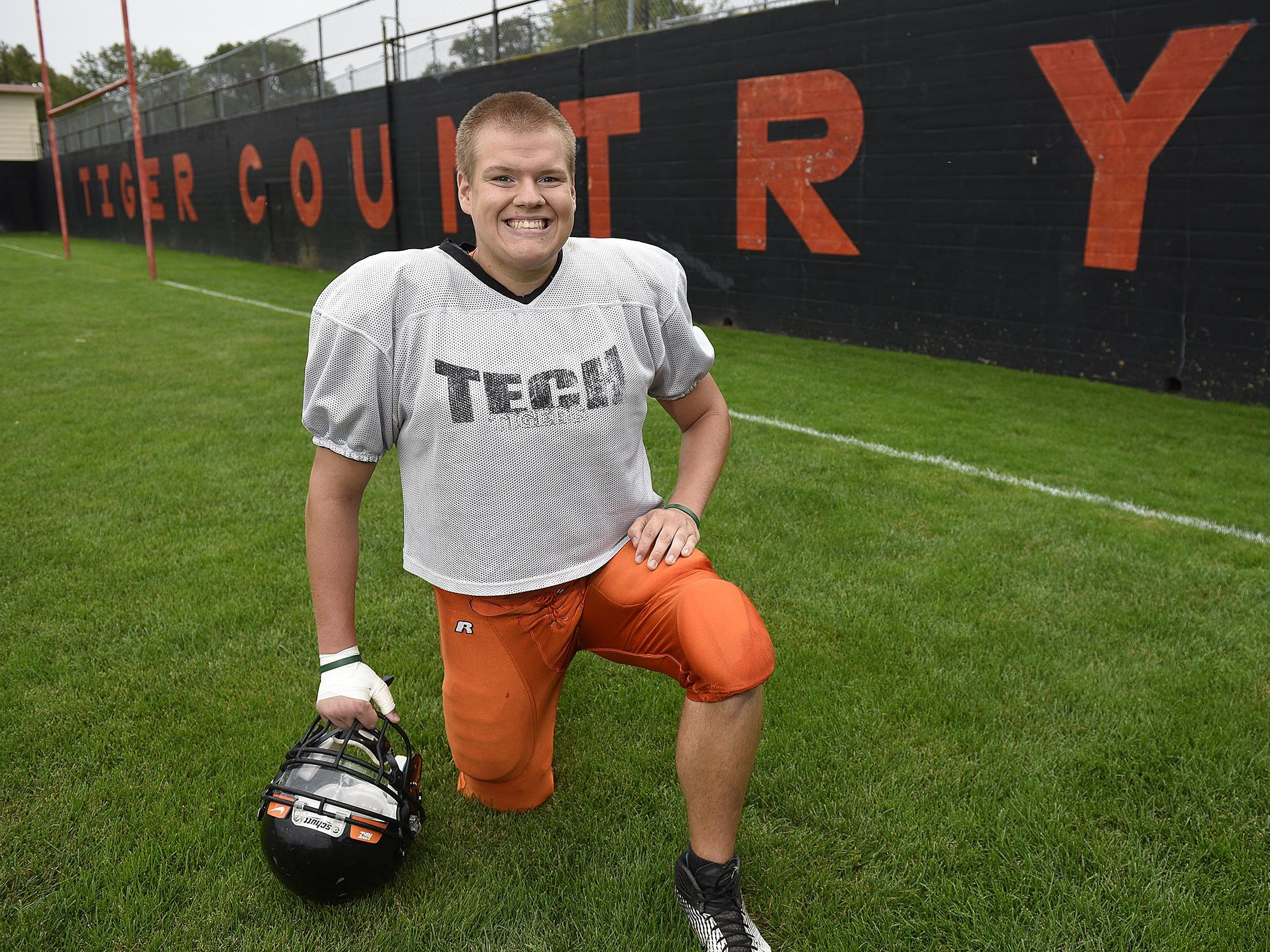 St. Cloud Tech's Jonathan Karels smiles Wednesday during practice at Clark Field.