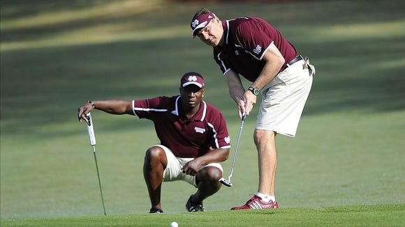 Mississippi State coach Dan Mullen putts as former Bulldog Fred McCrary looks on during the Chick-fil-A Challenge at the Reynolds Plantation Resort on April 30, 2013.