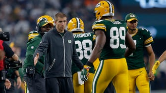 Packers wide receiver Jordy Nelson (left) greets players during the first quarter.