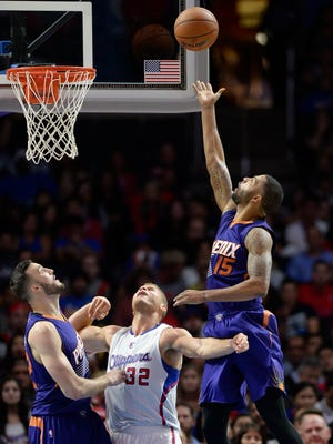 Phoenix Suns forward Marcus Morris (15) shoots against Los Angeles Clippers forward Blake Griffin (32) during the second half at Staples Center.
