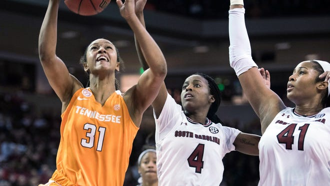 Tennessee forward Jaime Nared, left, attempts a shot against South Carolina guard Doniyah Cliney and Alaina Coates  during the second half Monday in Columbia, S.C.