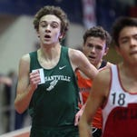 Drew Dorflinger from Pleasantville, left, makes his move as he comes in first place in the boys 3200 meter run at the Westchester County indoor track championships at The Armory in New York, Jan. 30, 2016.