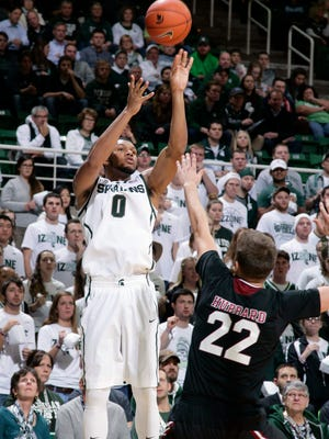 Michigan State's Marvin Clark Jr. shoots a 3-point shot against Santa Clara's Matt Hubbard Monday.