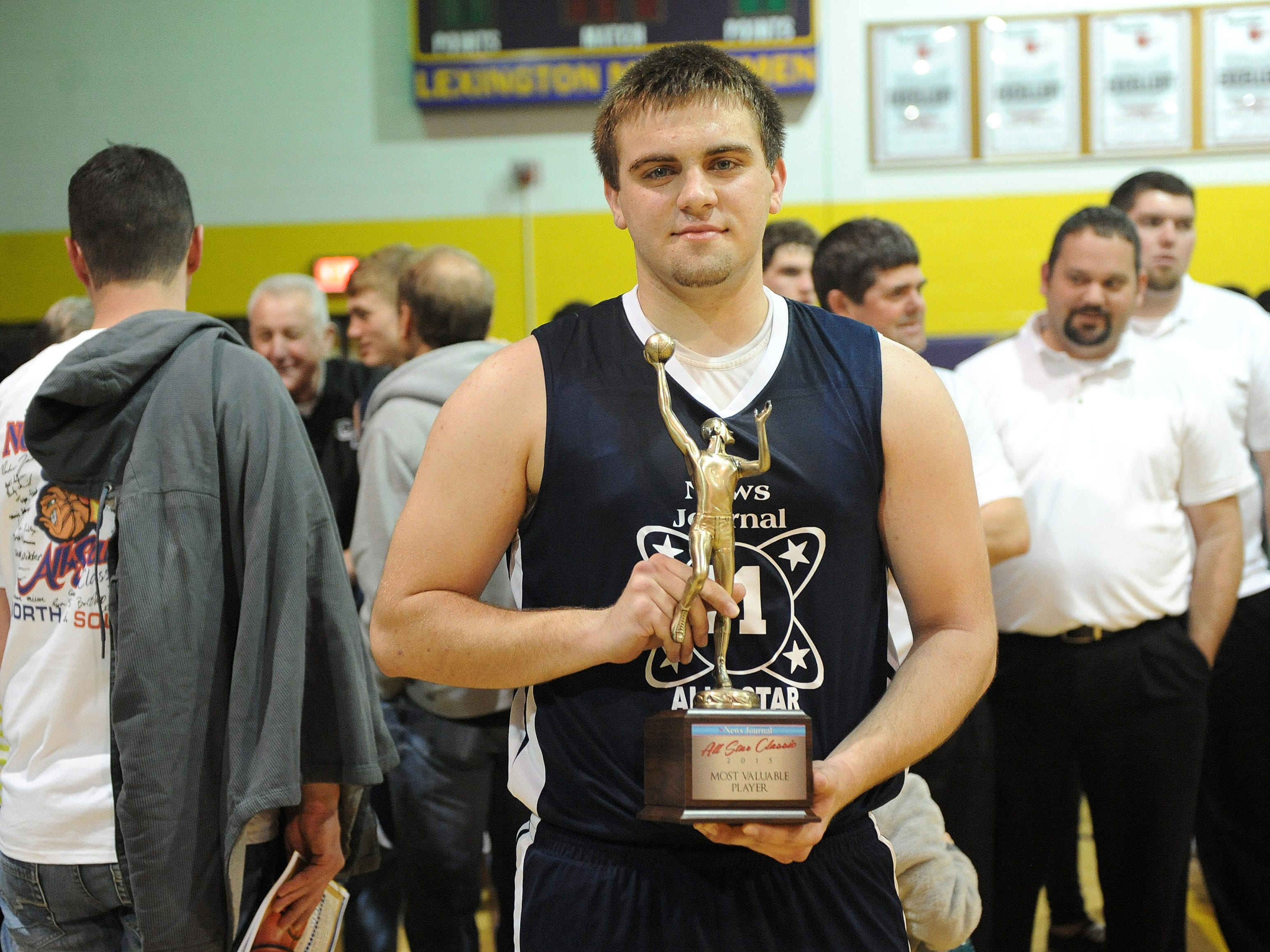 Tyson Beebe stands with a trophy after being named the MVP at Thursday night's 37th annual News Journal All-Star Basketball Classic game at Lextington High School.