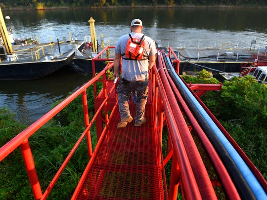 Michael Goff walks down the gangplank to the towboat where he spends almost a month at a time working on the Cumberland River near Nashville.
