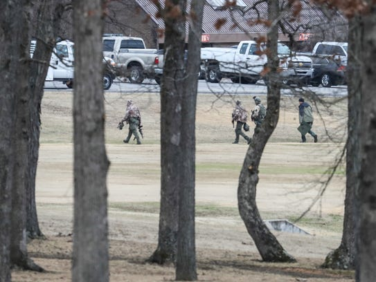 Police patrol the perimeter at Marshall County High