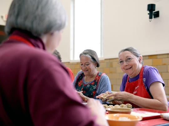 Karen Dravenstatt-Mocsri, left, and Joyce Brennan laugh as they make pierogi and talk with Marcia Mettert, foreground, at the Polish Federated Home  Tuesday, April 19, 2016 in Lansing in preparation for Pierogi Day.