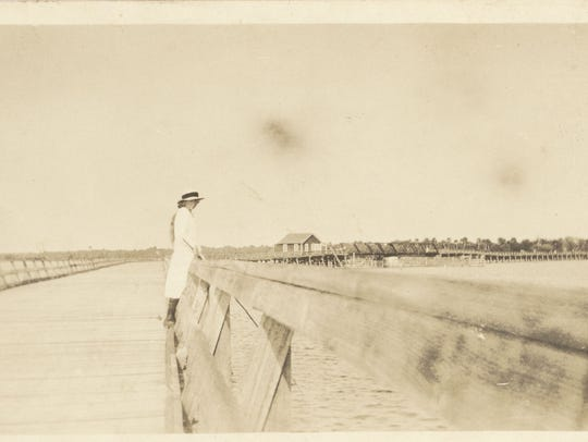 A pedestrian looks out over the Vero Bridge in the