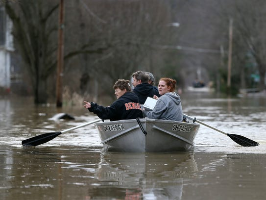Lesa Tomlin, left, gestures toward dry land as Lori
