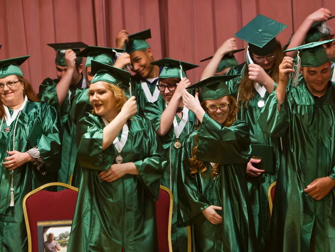 Members of The Excel Center's first graduating class move their tassels after receiving their proclamation of graduation Friday, May 9, 2014, at Duncan Hall in Lafayette. The alternative education program graduated 13 students Friday night.
