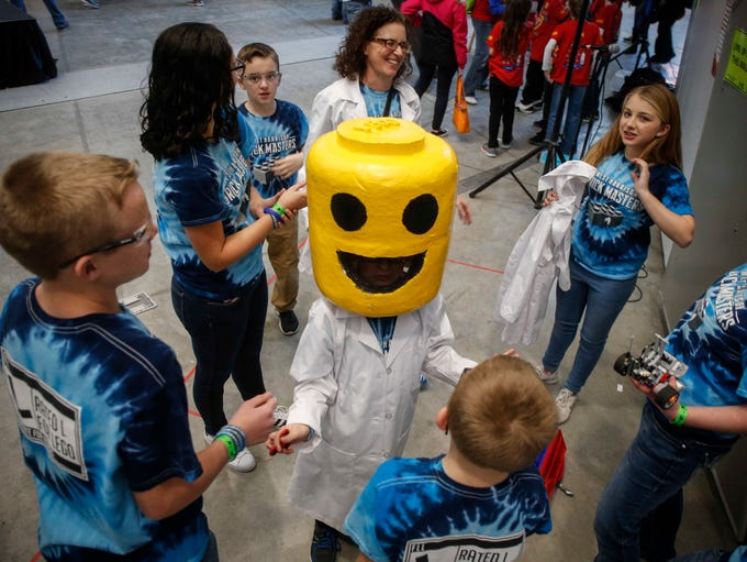 James Kraft, 11, of Mondamin, wears a Lego mask as