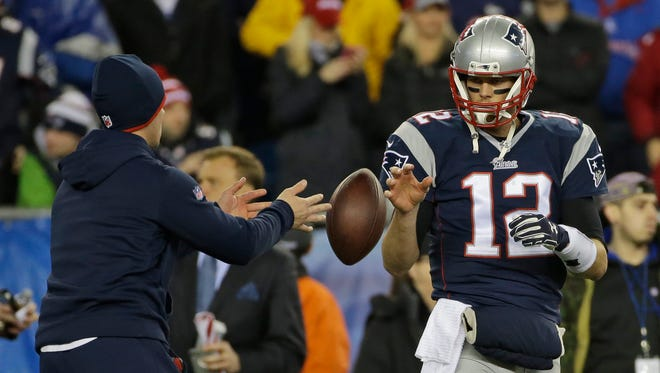 In this Sunday, Jan. 18, 2015, photo New England Patriots quarterback Tom Brady has a ball tossed to him during warmups before the NFL football AFC Championship game against the Indianapolis Colts in Foxborough, Mass.