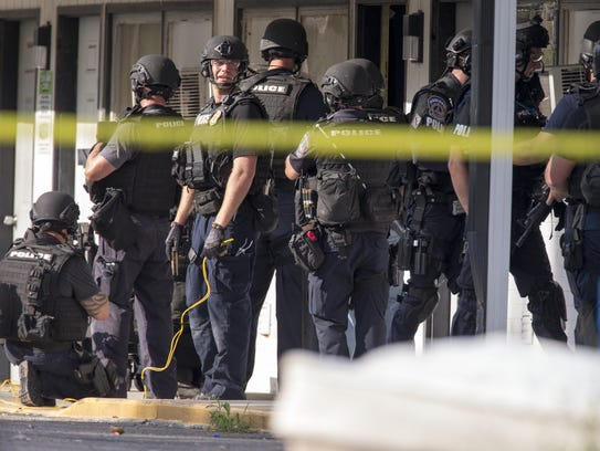 IMPD SWAT officers work a hostage situation at the