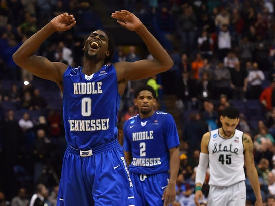 Middle Tennessee Blue Raiders forward Darnell Harris (0) reacts after his team upset Michigan State Spartans in the first round in the 2016 NCAA Tournament.