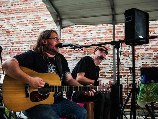 """June 4, 2017 - Adam McClelland, vocals and guitar, performs a song with drummer Saxton """"KiDd"""" Dover, cq'd, during the Sache Sunday Block Party at 525 S. Main St. on Sunday. Their group, called Adam McClelland and The Hangover, entertained the crowd during the event that was held to benefit the Memphis Food Bank."""