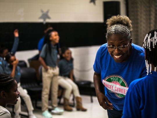 Vocal coach Angela Hyde listens to 10-year-old Miracle Blaine's voice during vocal practice through the AngelStreet program Sept. 21, 2017, at Bickford Community Center. AngelStreet serves youths in communities where art and music aren't being taught in schools. And African-American girls from North Memphis are using music and singing as a conduit to empowering themselves.