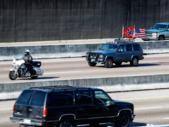 "January 06, 2018 - Police escort leads a convoy of protesters on I-240 as they demonstrate against the recent removal of Confederate monuments. The ""rolling rally,"" organized by the Facebook page Confederate 901, is expected to begin at noon as protesters drive to Health Sciences Park and Fourth Bluff Park, Confederate battle flags flying, from staging points in the suburbs and in Mississippi and Arkansas."